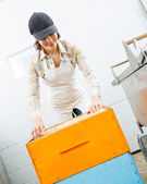 Female Beekeeper Arranging Honeycomb Frames — Stock Photo