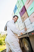 Beekeeper Tying Rope Stacked Honeycomb Crates On Truck — Stock Photo