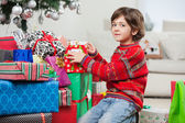 Cute Boy Kneeling By Christmas Gifts — Stok fotoğraf