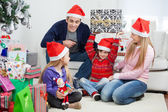 Playful Family With Christmas Gifts — Stock Photo