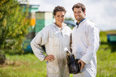 Beekeepers With Smoker Standing At Apiary — Stock Photo