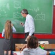 Girl Solving Mathematics On Board With Teacher — Stock Photo