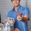 Mid Adult Man Holding Cupcake At Supermarket — Stock Photo