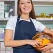 Saleswoman Holding Vegetable Basket In Grocery store — Stock Photo