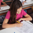 Teenage Schoolgirl Writing At Desk — Stock Photo