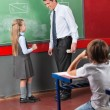 Schoolgirl And Male Teacher Looking At Each — Stock Photo