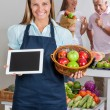 Saleswoman Holding Digital Tablet And Fruits Basket — Photo