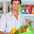 Man With Vegetable Basket In Grocery Store — Stock Photo
