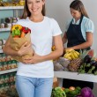 Woman Holding Grocery Bag At Supermarket — Stock Photo