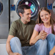 Woman Holding Man's Hand At Laundromat — Stock Photo