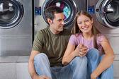 Woman Holding Man's Hand At Laundromat — Stock Photo