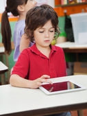 Little Boy Using Digital Tablet In Kindergarten — Stock Photo