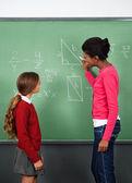 Female Teacher Teaching Mathematics To Schoolgirl — Stock Photo