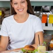 Young Woman With Burger And Drink At Table — Stock Photo