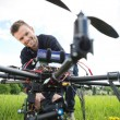 Stock Photo: TechniciAssembling CamerOn UAV Drone