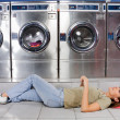Woman Listening To Music While Lying At Laundry — Stock Photo