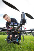 Technician Assembling Camera On UAV Drone — Stock Photo