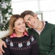 Loving Couple At Home During Christmas — Stock Photo #34140589