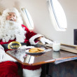 Santa Sleeping In Private Jet — Stockfoto