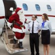 Santa Thanking Pilot And Airhostess While Disembarking Private J — Stock Photo