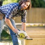Carpenter Using Circular Saw — Stock Photo #34165531