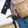 Hammer Hanging In Tool Belt Of Carpenter — Stock Photo #34167841