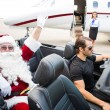Santa Waving Hand While Chauffeur Driving Convertible Against Pr — Stock Photo