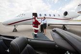 Private Jet Crew Greet Santa — Stock Photo