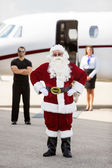 Santa Standing With Bodyguard And Airhostess Against Private Jet — Stockfoto
