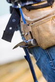 Hammer Hanging In Tool Belt Of Carpenter — Stock Photo