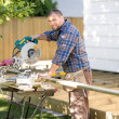 Carpenter Cutting Wood Using Table Saw At Site — Stock Photo