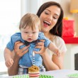 Stock Photo: Mother With Baby Boy Celebrating Birthday At Home