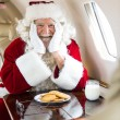 Santa With Cookies And Milk Sitting In Private Jet — Stock Photo