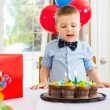 Birthday Boy Licking Lips While Looking At Cake — Стоковое фото