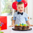 Birthday Boy Licking Lips While Looking At Cake — Stockfoto