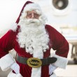 Santa Standing With Hands On Hip Against Private Jet — Stock Photo