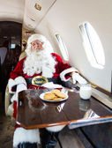 Santa With Eyes Closed Relaxing In Private Jet — Stock Photo