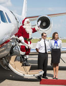 Santa Waving On Private Jet — Stock Photo