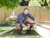 Manual Worker Drilling Wood At Construction Site — Stock Photo