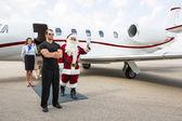 Santa Waving Hand Against Private Jet — ストック写真