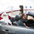 Santa Waving Hand While Driver Driving Convertible Against Priva — Stock Photo