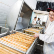 Stock Photo: Happy Beekeeper Working On Honey Extraction Machine