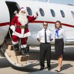 Santa Waving Hand On Private Jet — Stock Photo #34246925