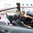 Santa And Driver In Convertible With Jet in Background — Stok fotoğraf