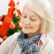 Senior Woman In Front Of Christmas Tree — Stock Photo