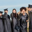 Graduate Students Looking Through Diplomas On Campus — Foto Stock