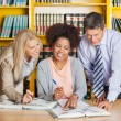 College Teachers Assisting Student With Studies In Library — Stock Photo #34249315