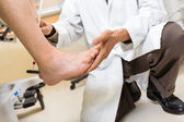 Doctor Examining Patient's Foot In Hospital — Stock Photo