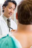 Doctor Looking At Patient While Discussing Report — Stock Photo