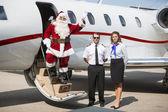 Santa Waving Hand On Private Jet — Stock Photo